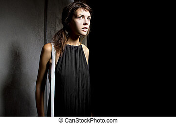 Lost Girl in a Dark Alley - young female walking lost and...