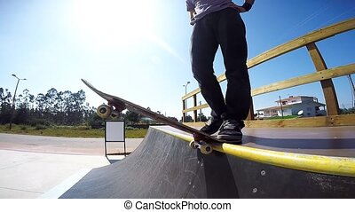 Skateboarder dropping a ramp - Slow motion shot of a...