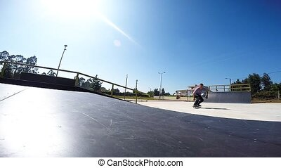 Skateboarder performing an ollie gr