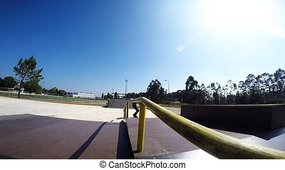 Skateboarder sliding down rail