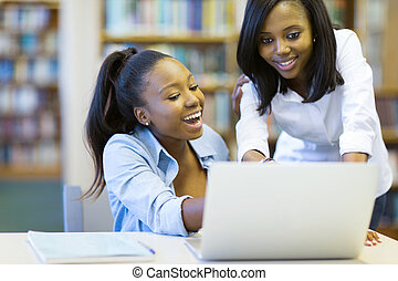 african american college students using laptop