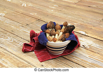 Wild Morel Mushrooms in a Crock wit - Close-up of a towel...