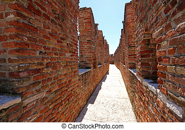 Castle Fortress in Verona, Italy - A small path between...