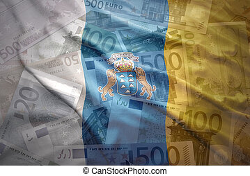 colorful waving canarian flag on a euro money background