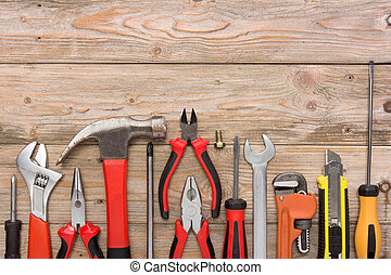 mechanical kit in wooden background. construction tool