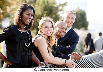 Business Team - A business team outside - sharp focus on...