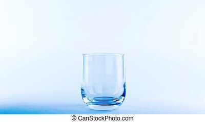 water movement pouring in glass on white background blue...