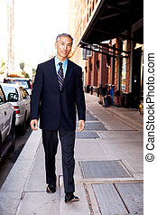 Business Man on Street - An asian looking business man...