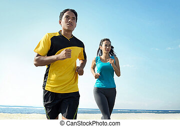 Couple running on beach, Sport concept