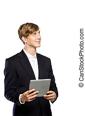 Young businessman in suit with a tablet pc on his hand, looking