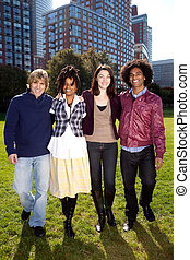 University Students - A group of college students in a park...