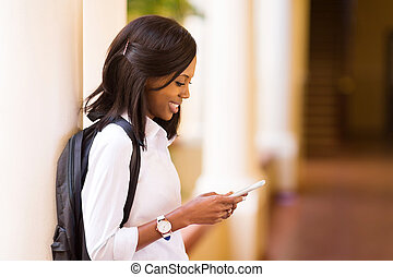 female afro american university student using cell phone -...