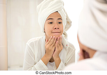 Young asian woman pressing her face, trying remove acne - A...