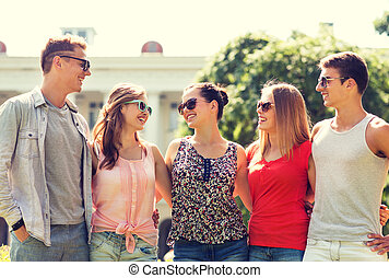 group of smiling friends outdoors - friendship, leisure,...