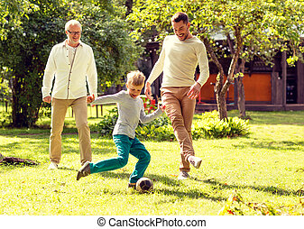 happy family playing football outdoors - family, happiness,...