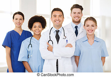 group of happy doctors at hospital - hospital, profession,...
