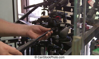Customers looking for new camera tripods and heads at...