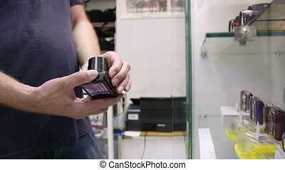 Customer looking for new compact camera at photographic...