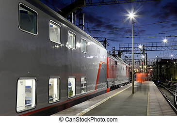 Train on Leningrad railway station at night -- is one of the...