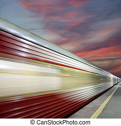 High-speed train with motion blur outdoor (against the sky)