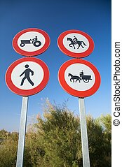 four traffic signs - group of highway access prohibit...