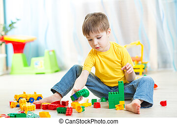 child boy plays with construction