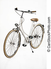 Bicycle - Womans classic bicycle on an isolated white studio...