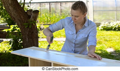 Woman with brush painting - Woman with brush painting wooden...