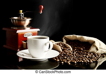Cup of coffee with saucer,bag,coffee beans on black - Cup of...