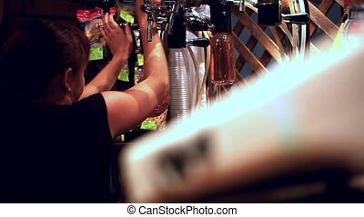 Female bartender pours the beer into a bottles HD 1920x1080...