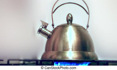 Tea kettle with boiling water on gas stove. HD. 1920x1080