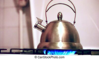 Tea kettle with boiling water on gas stove HD 1920x1080