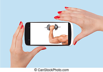 Online dating. Female hands holding smartphone with picture...