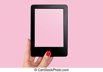 E reader. - Female hand with red nails holding e reader...