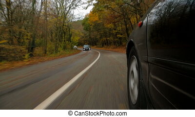Passenger Car Moving Along Winding Road In Autumn Forest -...
