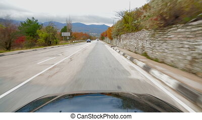 Passenger Vehicle Moving Along Asphalt Road With Scenics...