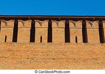 Embrasure in the defense wall of red bricks of ancient city