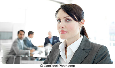 Close-up of a businesswoman in a wheelchair during a meeting...