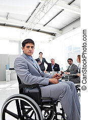 Young businessman in a wheelchair