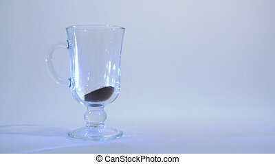 Glass cup of coffee - Instant coffee is poured water