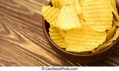 Potato chips, close-up - the rotation