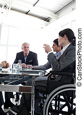 Attractive businesswoman in a wheelchair during a meting...