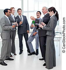 Nice business people celebrating a success with Champagne