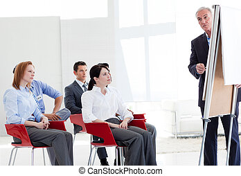 Multi-ethnic business people at a seminar in the office