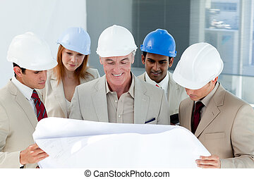 A group of architect discussing a project