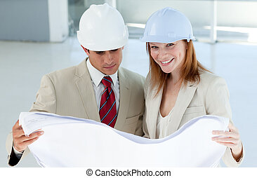 Two architects discussing a construction plan in a building...