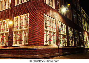 amsterdam - brick house at night in amsterdam