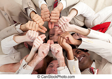 Successful business team with thumbs up lying in a circle -...