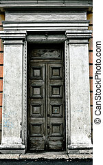 old terrible door with cracked columns