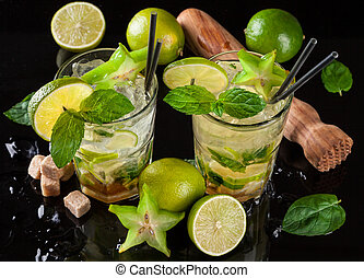 Mojito drinks on black stone - Mojito drinks served on black...